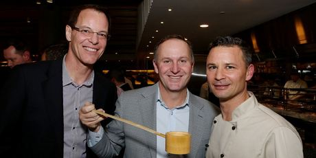 John Key does the honours at Masu, with Simon Dallow and owner Nic Watt.