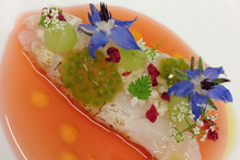 Paul Froggatt's New Zealand langoustine with strawberry and tomato bouillon, tomato puffed rice and chervil flowers. Photo / Supplied.