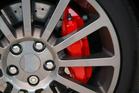 Alloy Wheel With A Red Brake Caliper Photo / Thinkstock