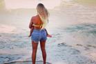 Beyonce and daughter Blue Ivy enjoying the Kiwi surf.