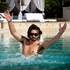 Colin splashes about in the pool at Palazzo Versace, wearing Versace sunglasses. Photo / Natalie Slade