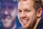With fresh hard tires, Sebastian Vettel blasted past Grosjean on lap 41 to take the lead for good. Photo / AP