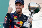 Red Bull driver Sebastian Vettel of Germany celebrates after winning the Japanese Formula One Grand Prix at the Suzuka circuit in Suzuka, Japan. Photo / AP