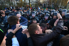 Protesters clash with police officers as they try to block the way during a protest in Moscow. Photo / AP