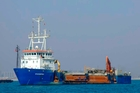 The Belgian ship Pompei, owned by De Nul, is shown in unidentified waters. One of Somalia's most notorious pirate leaders, Mohamed Abdi Hassan, was arrested in Brussels. Photo / AP