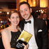 New Zealand author Eleanor Catton holds her prize and poses with her partner for photographers after winning the Man Booker Prize for Fiction, in central London. Photo / AP