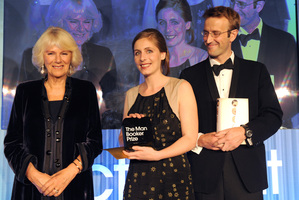 New Zealand author Eleanor Catton, center, holds her prize and stands with the Duchess of Cornwall and Robert Macfarlane, Chair of judges, after winning the Man Booker Prize. Photo / AP
