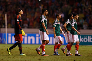 Players of Mexico leave the field of play after their 1-2 lost against Costa Rica during a 2014 World Cup qualifying soccer match in San Jose, Costa Rica. Photo / AP