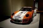 A 2010 Porsche Type 911 GT3 R Hybrid Race Car Prototype on display in the Porsche By Design exhibit at the North Carolina Museum of Art in Raleigh, N.C. Photo / AP