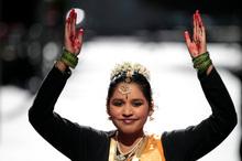 Aishwarya Bala leads the Bharatha Nattiyam dance group in a performance.Photo / Michael Craig