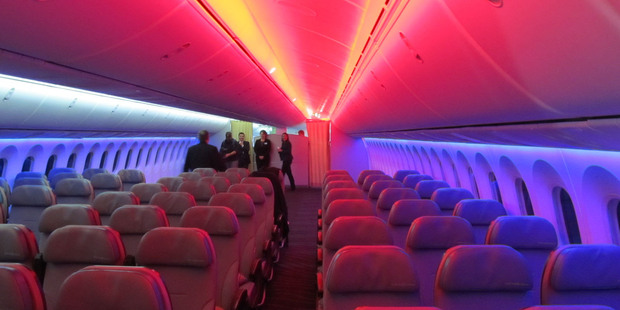 The disco-style coloured lighting on board the new Boeing 787 Dreamliner. Photo / Grant Bradley