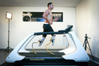 19-year-old University of Canterbury commerce student, Liam Malone, who lost both legs at the age of two, trials his new running-blades for the first time on a treadmill. Photo / Martin Hunter.