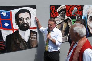 Art teacher Chris Wilkie and Bishop Ben Te Haara with a portrait of Maori MP Hone Heke Ngapua.
