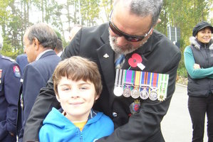 War veteran Mike Joyce - seen here with grandson Asher Carswell-Joyce at a Kawakawa Anzac Day ceremony - has been reunited with his medals.