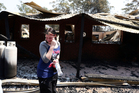 A distraught Stephanie Burton, 16, walks through the remains of a property in the Blue Mountains. Photo / Renee Nowytarger