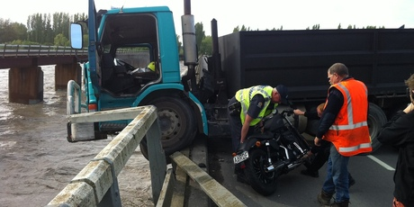 A close call for the driver of this motorcycle who ended up clinging to a tree in the flooded Waimakariri River this morning. Photo / APNZ