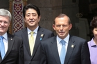Japanese Prime Minister Shinzo Abe and (right) Australian Prime Minister Tony Abbott. Photo / AP