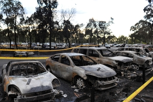 Burned-out vehicles line the carpark next to the Sydney Aquatic Centre. Winds gusting up to 70km/h fanned the flames which destroyed 47 cars and damaged 33 others. Photo / AAP