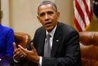 If President Barack Obama does not avoid a default the market reaction will be extremely violent, says AMP. Photo / AP