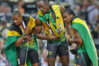 Usain Bolt of Jamaica after winning the gold in the final of the 200m, with teammates Warren Weir and Yohan Blake. Photo / Brett Phibbs