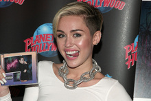 Miley Cyrus attends an album release signing event. Photo / AP