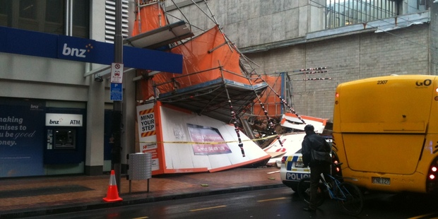 The high winds brought down this scaffolding on Willis Street in Wellington, although there were no injuries. Photo / Richard MacLean