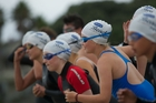 Hundreds of young athletes take part in the weekly swim series at Takapuna Beach over summer.