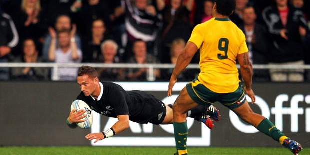 Aaron Cruden backs up impressively to score against Australia on Saturday night in Dunedin. Photo / Getty Images