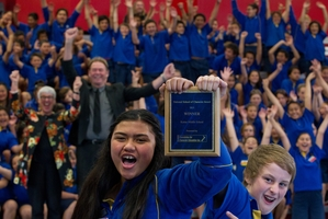 STUDENT SUCCESS: Kaitao Intermediate School head girl Tyla Leo (left) and head boy Stacee Jones with Rotorua Mayor Steve Chadwick (back left) and principal Rory O'Rourke celebrate their National School of Character award. PHOTO/STEPHEN PARKER 251013SP1