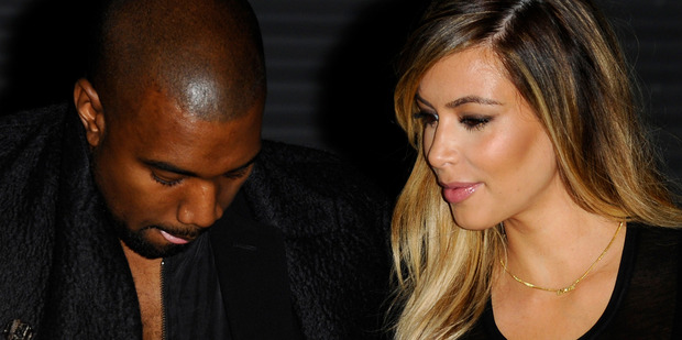 Loading Kanye West and Kim Kardashian are engaged, it has been confirmed. Photo / AP