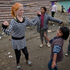 Minka Ruseva, daughter of Sasha Ruseva, left, dances along with other children in a Roma neighborhood of Nikolaevo, Bulgaria. Photo / AP
