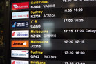 Auckland Airport's new display boards show flight details in Mandarin as well as English.