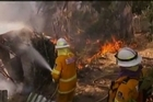 Firefighters are battling some of the most destructive wildfires to ever strike Australia's most populous state. Authorities warned that high temperatures and winds were likely to maintain heightened fire danger for days in New South Wales.