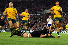 Kieran Read scores during the All Blacks' Bledisloe Cup win over the Wallabies at Forsyth Barr Stadium last night. Photo / Getty Images