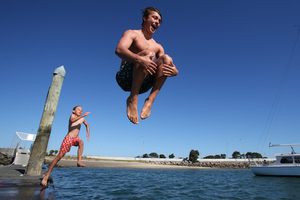 Louis Gordon jumps off Bridge Marina with his brother Dom.  Photo / Joel Ford