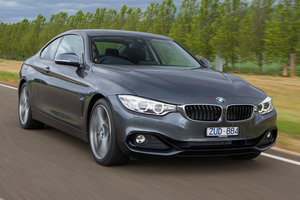 "The ""shark nose"" grille on the 4 Series merges with the front headlights."