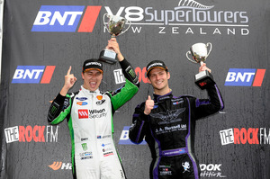 V8 SuperTourers round winners and series leader Ant Pedersen and Chaz Mostert celebrate their win on podium at Hampton Downs. Photo / Geoff Ridder
