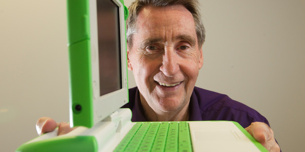 Professor Vercoe with the XO laptop he helped to develop. Photo / Alan Gibson