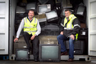 Gavin Mortlock from Royal Wolf (left) and Dru Mackie from RCN Group with a container of old TVs. Photo / Natalie Slade
