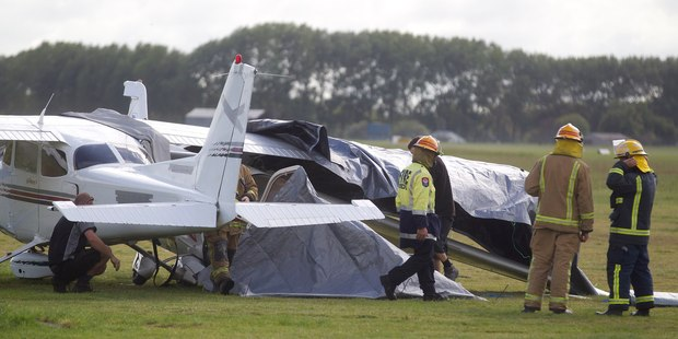 A light aircraft has crashed into a parked plane after an emergency landing this morning at the Waikato Aero Club. Photo /  Christine Cornege