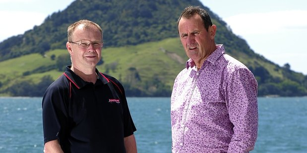Detective Sergeant Pete Blackwell (right),  Tauranga Police CIB Charity Auction organiser,  yesterday presented Tauranga Coastguard operations manager Simon Barker (left) with a cheque for $80,000. Photo / George Novak