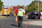 Police investigate a crash in Pukekohe yesterday involving a car and a fire engine. Photo / Kellie Blizard