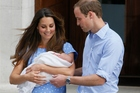 Prince William and Kate, Duchess of Cambridge when they first left the hospital with Prince George.Photo / AP