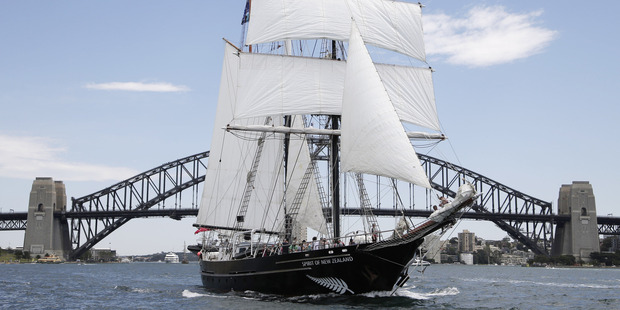 The Spirit of New Zealand sails past the Sydney Harbor Bridge on its way to the start of the Sydney Auckland Tall Ships Regatta in Sydney. Photo / AP