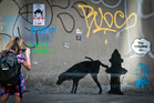 Oct 4 file photo of graffiti by the secretive British artist Banksy, featuring a dog and a fire hydrant. Photo / AP