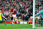 Arsenal's Aaron Ramsey, centre, shoots to score past Norwich City's goalkeeper John Ruddy, during their English Premier League soccer match, at the Emirates Stadium. Photo / AP