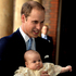 Prince William, holds his son Prince George.Photo / AP