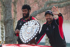Sikeli Nabou right) with the Ranfurly Shield.