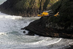 Helicopters were used in the search for the three who went missing after plunging from the rock into stormy seas.  Photo / Christine Cornege