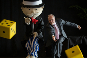 Mr Monopoly and Auckland Mayor Len Brown compare notes after the announcement today that Monopoly will make a game board for Auckland.